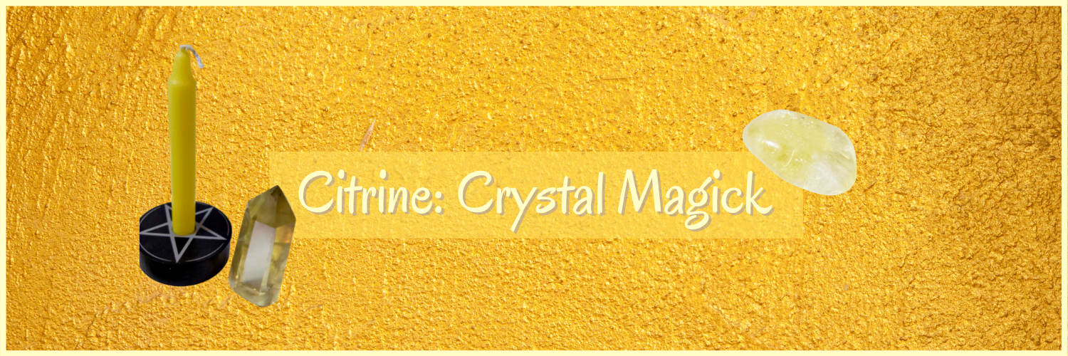 Citrine point and tumble stone with a yellow candle in a black candle holder